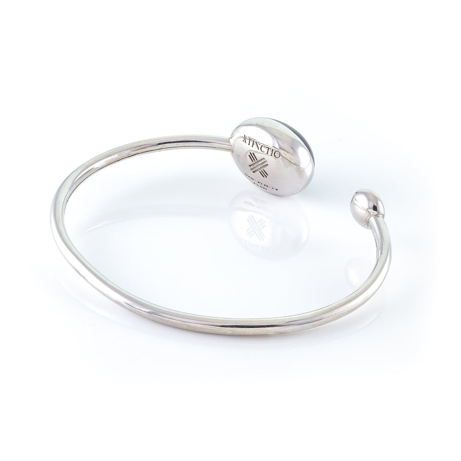 Xtinctio - Bangle Hand made in Italy eco conscious,  925 Sterling  Silver with triple dipped platinum and enamel. Imbued with the spirit of our endangered Sea Mammals, in particular the whale