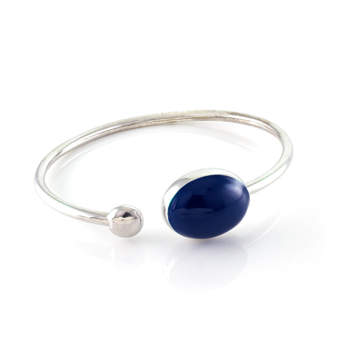 Xtinctio - Flexible Bangle timeless, comfortable and chic Hand made in Italy by a 3rd generation Goldsmith eco conscious with triple dipped platinum and  enamel.  Imbued with the spirit of our endangered Sea Mammals/ Whale  Xtinctio - Bangle Hand made in Italy eco conscious,  925 Sterling  Silver with triple dipped platinum and enamel. Imbued with the spirit of our endangered Sea Mammals, in particular the whale