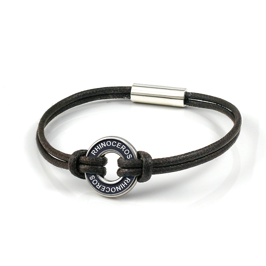 Xtinctio Bracelet - Individually hand forged in Italy from White Bronze and black Etruscan Enamel in honor of the critically endangered Rhino.  Eco friendly cotton linen blend waxed cord sourced in Italy