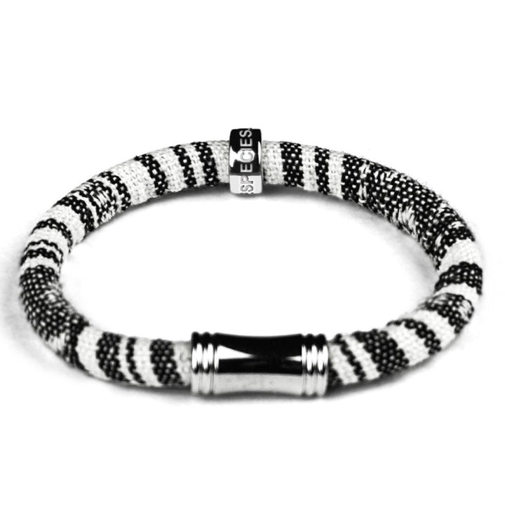 Highly Durable, Comfortable, Fun and well made . Eco-conscious linen/cotton blend RHINO HOPE bracelet is hand made.  Easy on, easy off magnetic clasp. Each color represents White and Black Rhino species