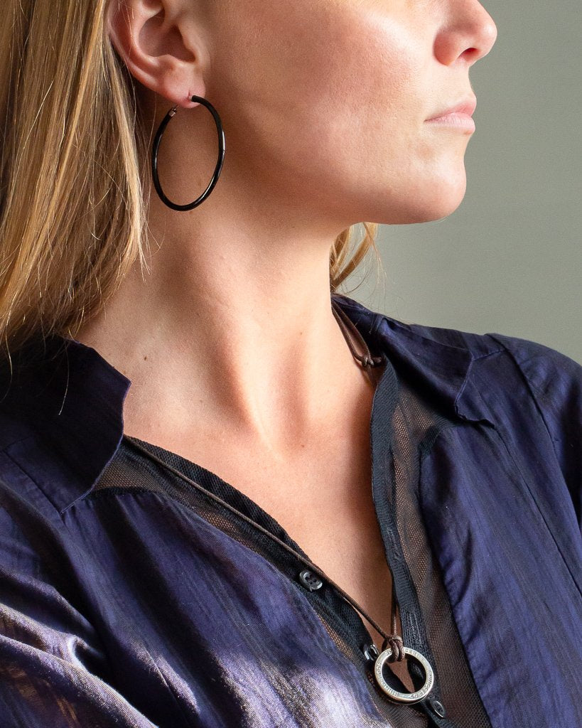 "Xtinctio - These eco conscious Grey Hoop Earrings and attached circle pendant engraved with the word ""Elephant"" are hand made"