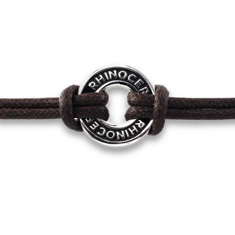 Xtinctio Bracelet - Individually hand forged in Italy from White Bronze and black Etruscan Enamel in honor of the critically endangered Rhino.  Eco friendly cotton linen blend waxed cord sourced in Italy.