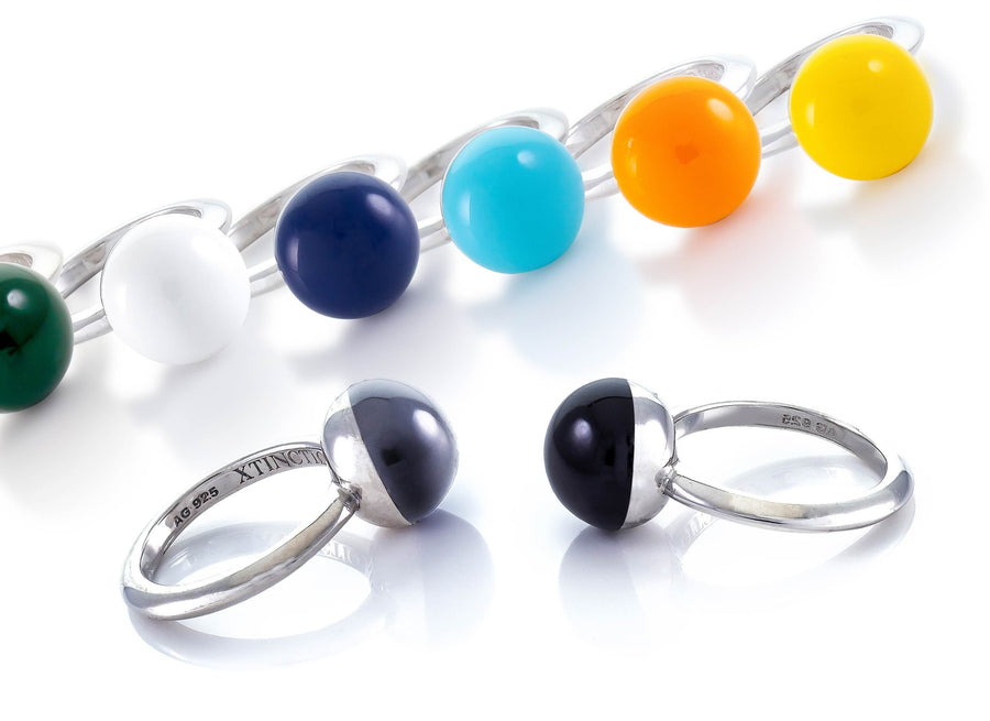 Made in Italy by a 3rd generation Goldsmith. Eco conscious white Bronze and glass enamel. 50% of all profits go towards protecting the most endangered species on the planet earth. Each ring is engraved with the endangered animal or habitat it represents. Collect them in all 8 colors! Xtinctio - Make a statement with the Etruscan Sphere ring.  Each ring is individually hand Made in Italy by a 3rd generation goldsmith using the ancient Etruscan Enameling method.  Imbued with the spirit of the Tiger