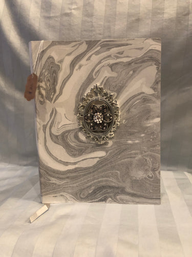 marble cover journal with framed flower charm