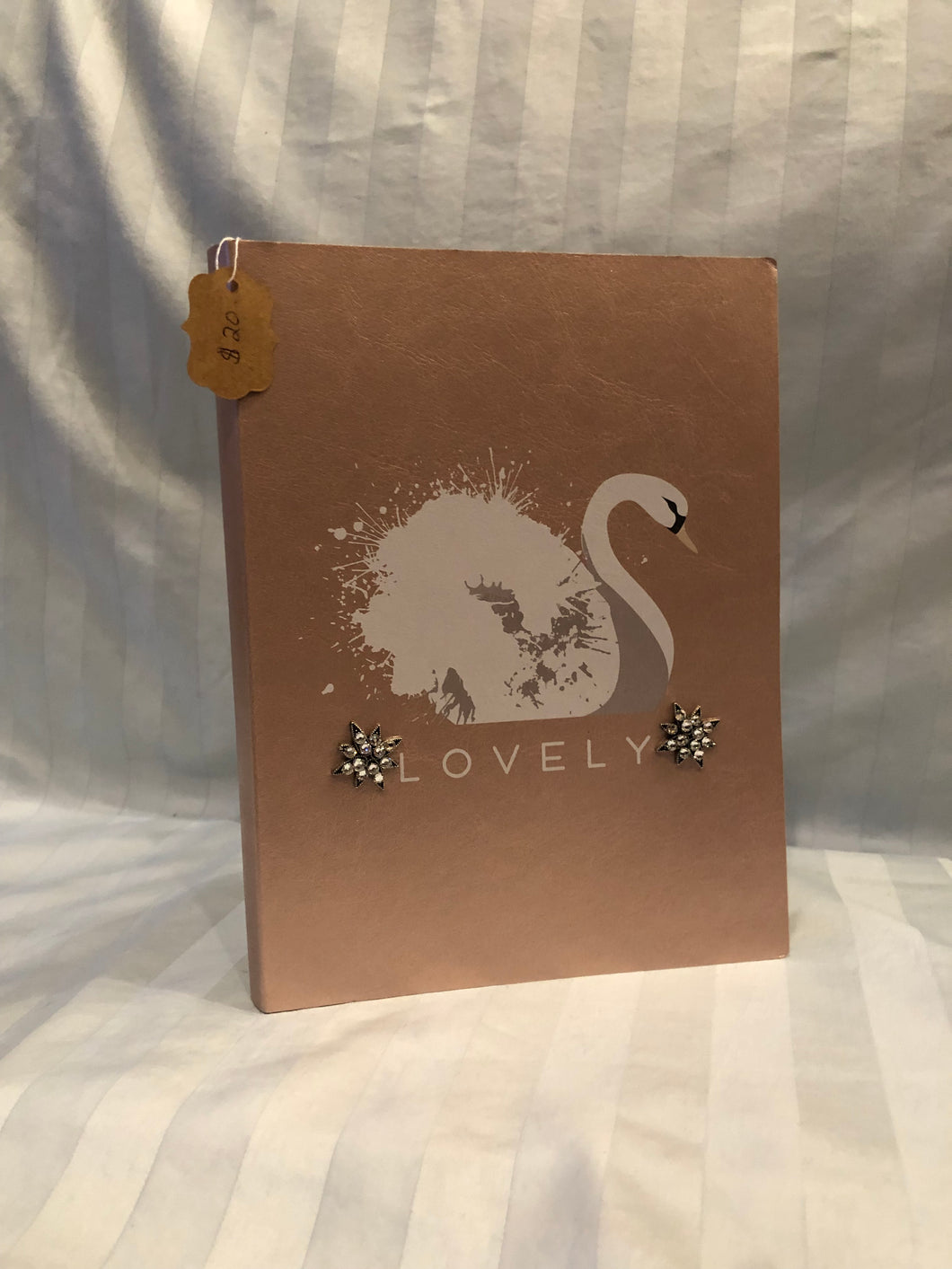 rose gold swan journal with flower charms