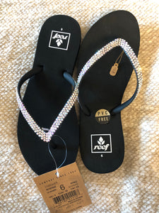 black reef flip flops with (iridescent)