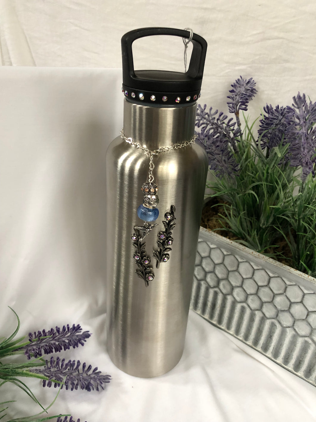 silver water bottle with floral and bird charm