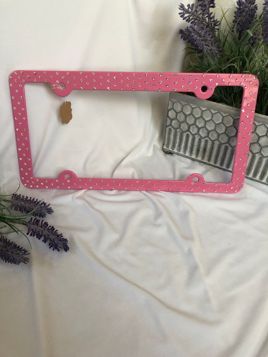pink metal license plate frame