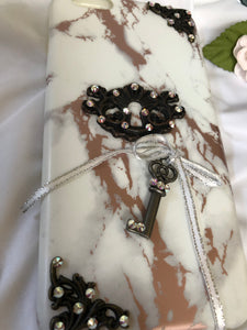 rose gold/white marble phone case with key/keyhole