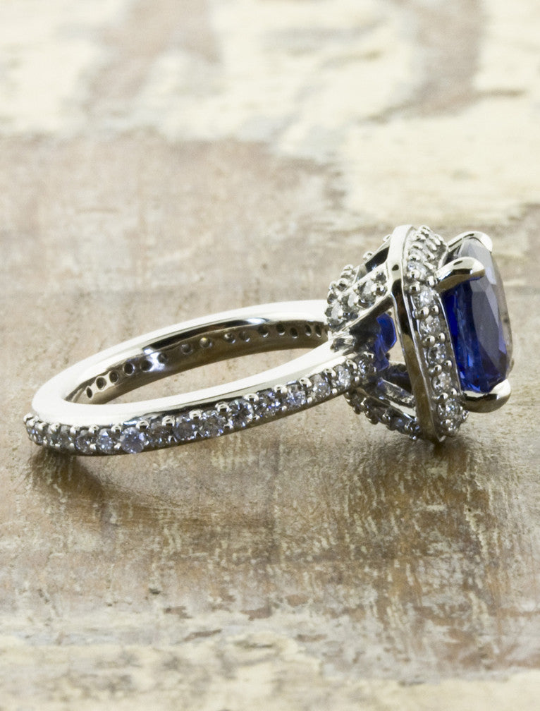 cultured blue sapphire, halo setting in palladium band