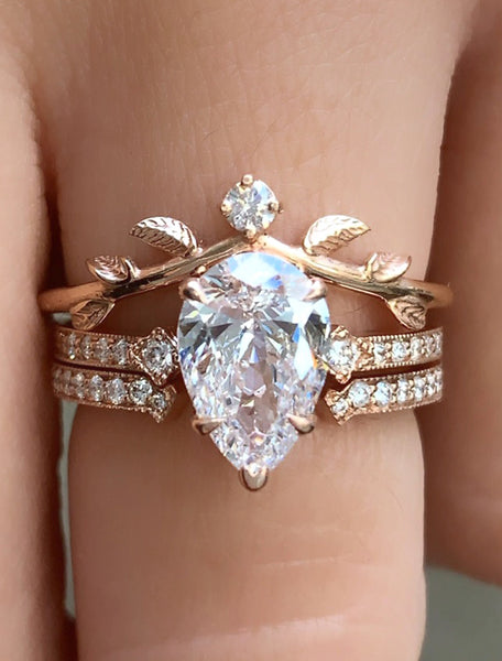 three ring engagement ring stack - pear shaped diamond
