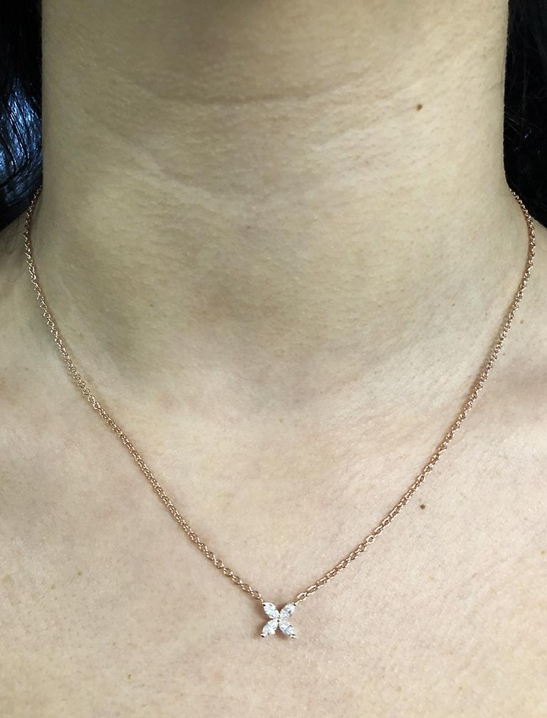 four diamond floral necklace shown on neck