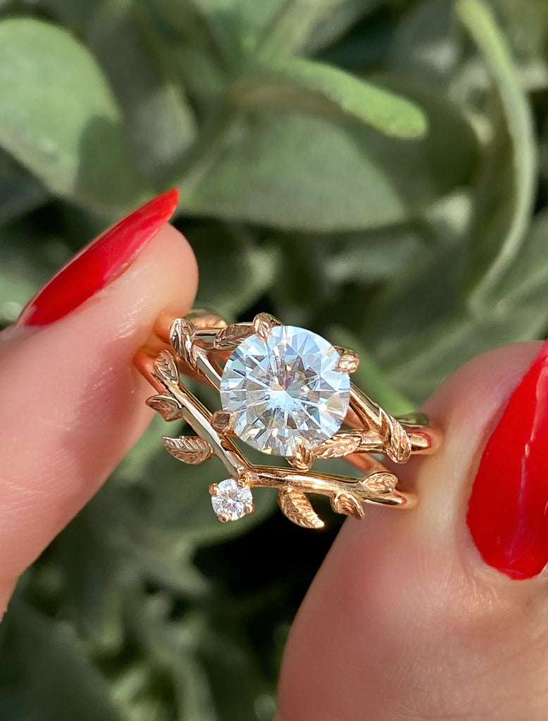caption:1.50ct. Round Diamond 14k Rose Gold paired with Adelixa wedding band