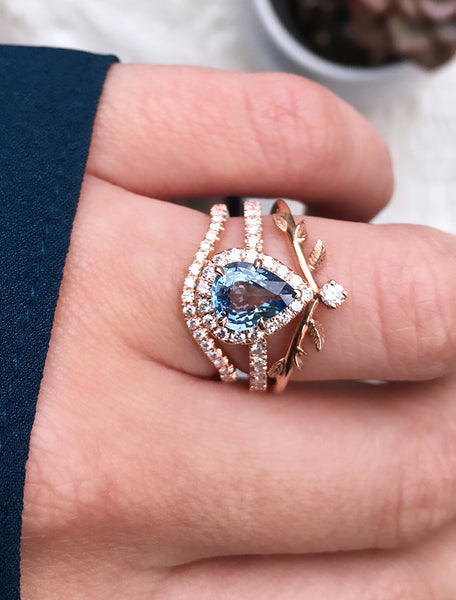caption:Customized with blue sapphire, and shown with Catherine and Adelixa wedding bands