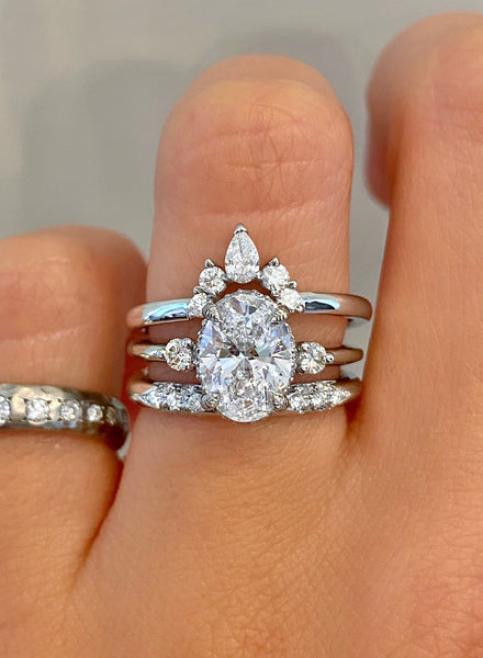 Vintage inspired engagement ring;caption:1.65ct. Oval Diamond Platinum paired with Laxmie and Abby wedding bands