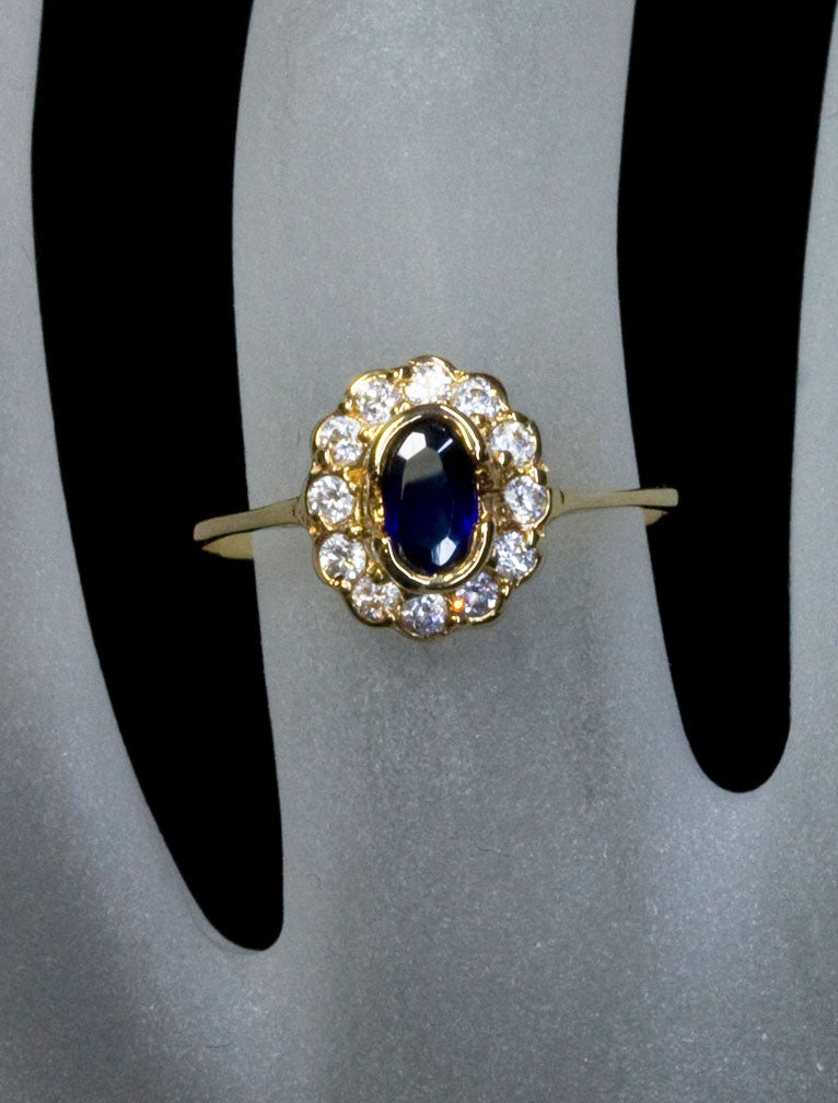 delicate halo, oval sapphire engagement ring