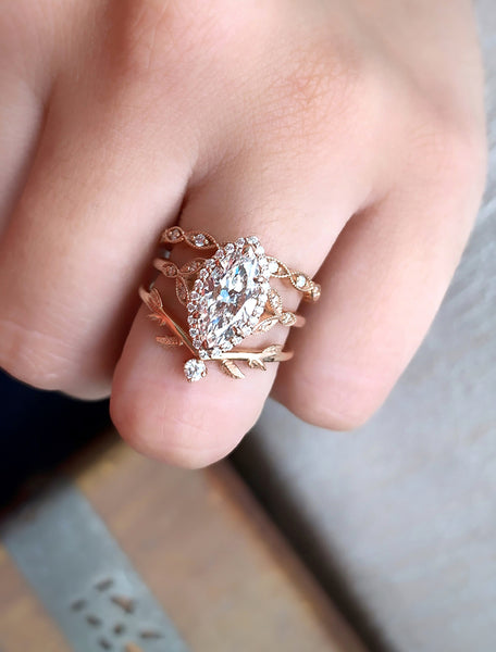 Vintage inspired engagement ring;caption:1.75ct. Marquise Diamond 14k Rose Gold paired with Lusia and Adelixa wedding bands