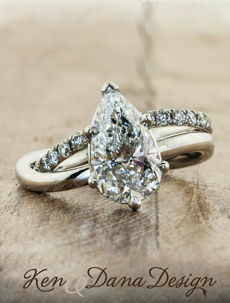 pear shaped diamond ring wave band;caption:2.09ct. Pear Diamond Platinum paired with Bella wedding band