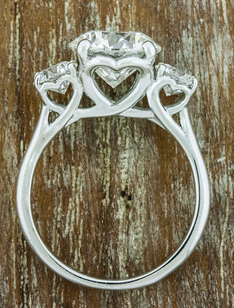 heart shaped setting, three stone diamond ring