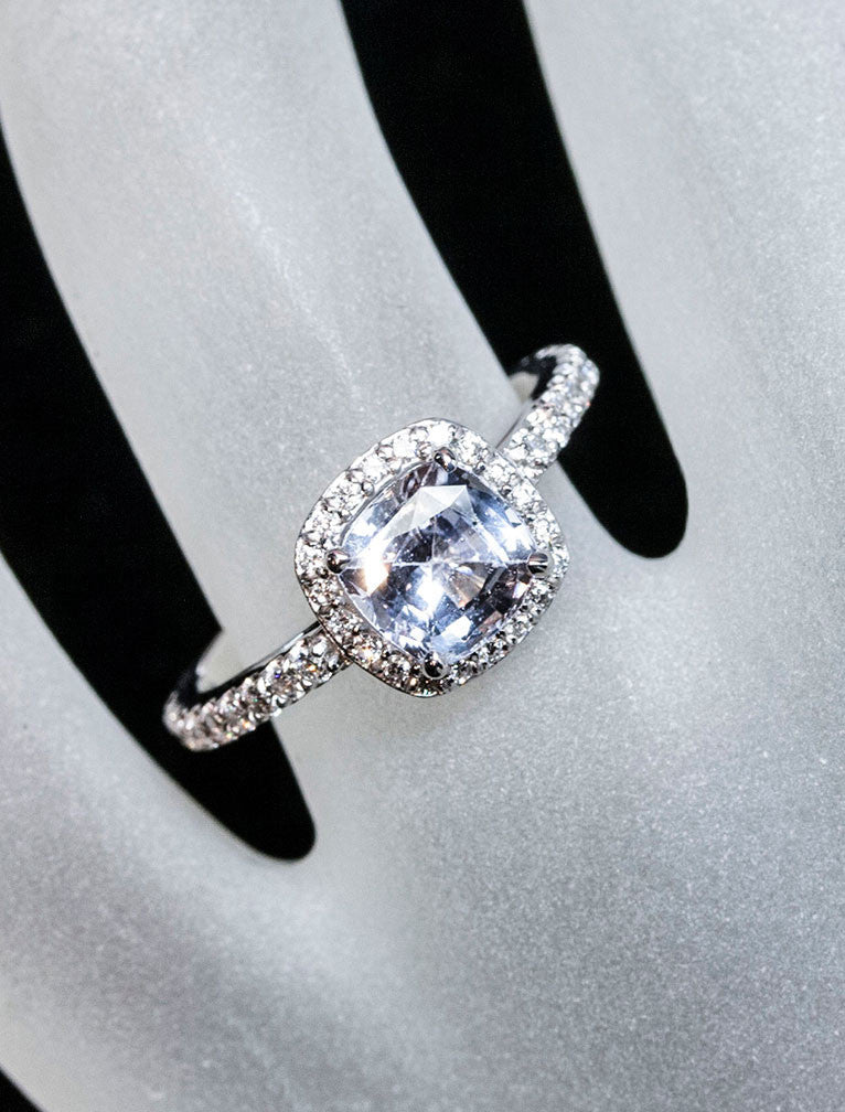 unique halo blue-grey cushion cut sapphire engagement ring