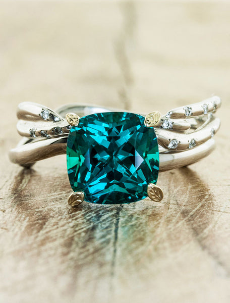 cushion cut emerald asymmetrical wave band, leaf prongs - matching band
