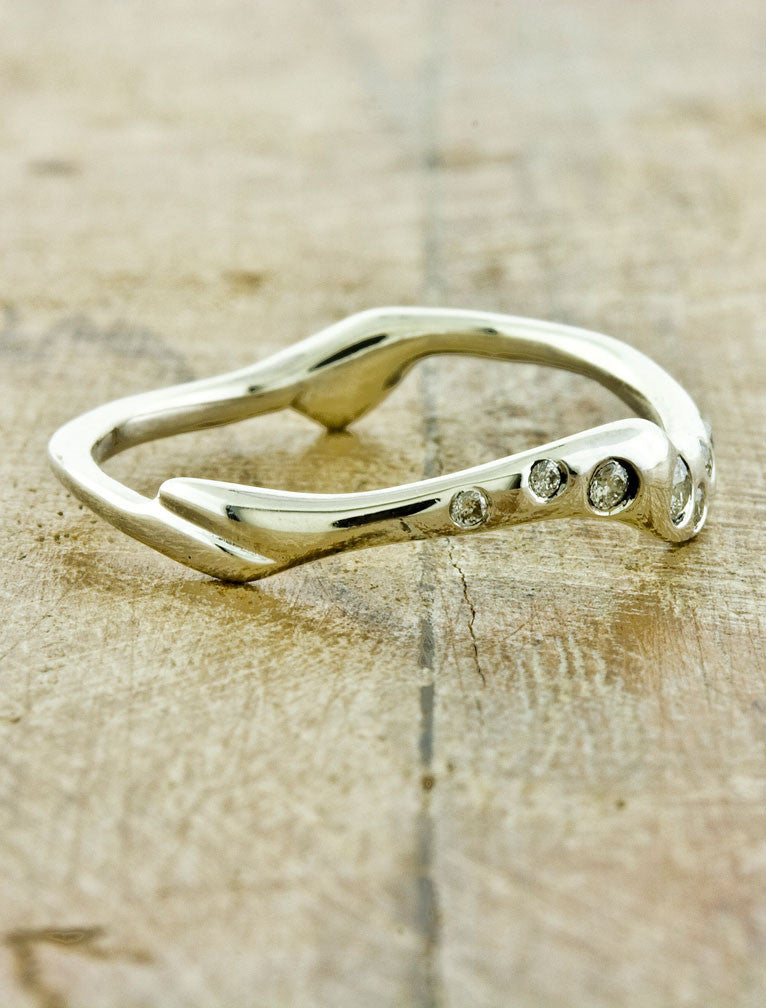 unique wave band wedding band with diamonds