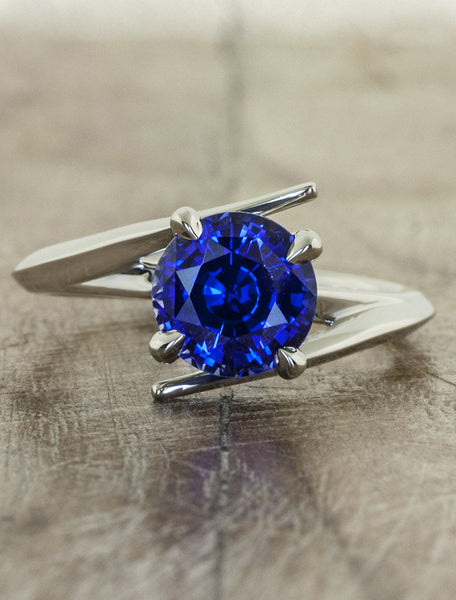 unique sapphire engagement ring, asymmetrical band.  caption:Customized with an 1.75ct. Round Sapphire, 14k White Gold