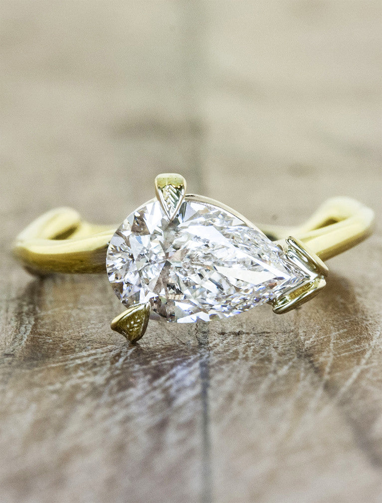Nature inspired pear shaped diamond engagement ring