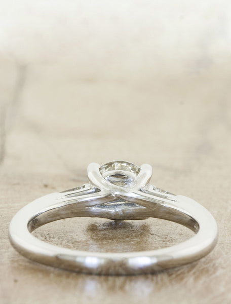 3-stone round diamond ring with baguette accents