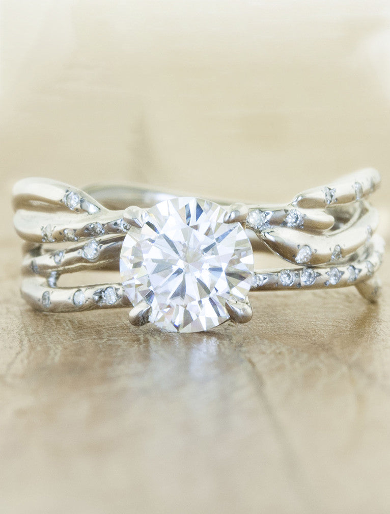 unique split shank diamond engagement ring with diamond accents. caption:1.00ct. Round Diamond Platinum paired with Selene wedding band