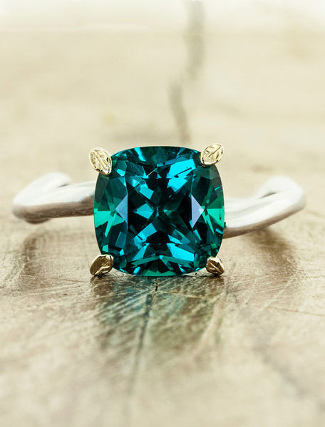 cushion cut emerald asymmetrical wave band, leaf prongs