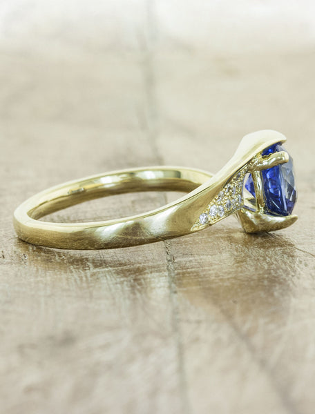 asymmetrical band sapphire engagement ring in yellow gold