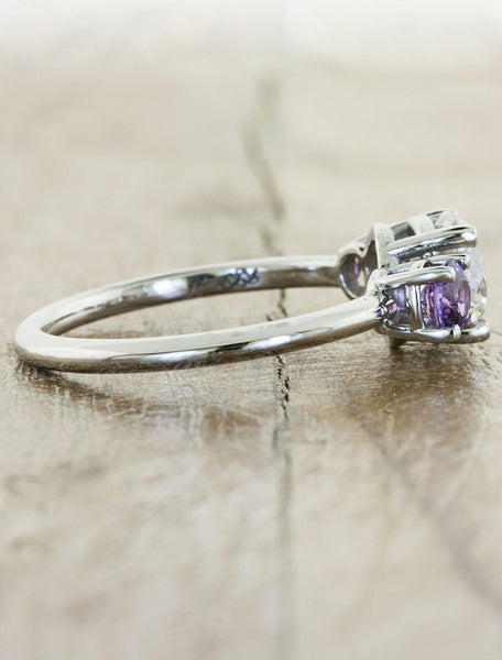 round diamond engagement ring, purple sapphire accents