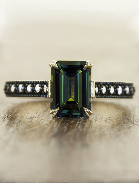 emerald cut green sapphire ring, black rhodium band caption:3.04ct. Radiant Cut Sapphire 14k Yellow Gold