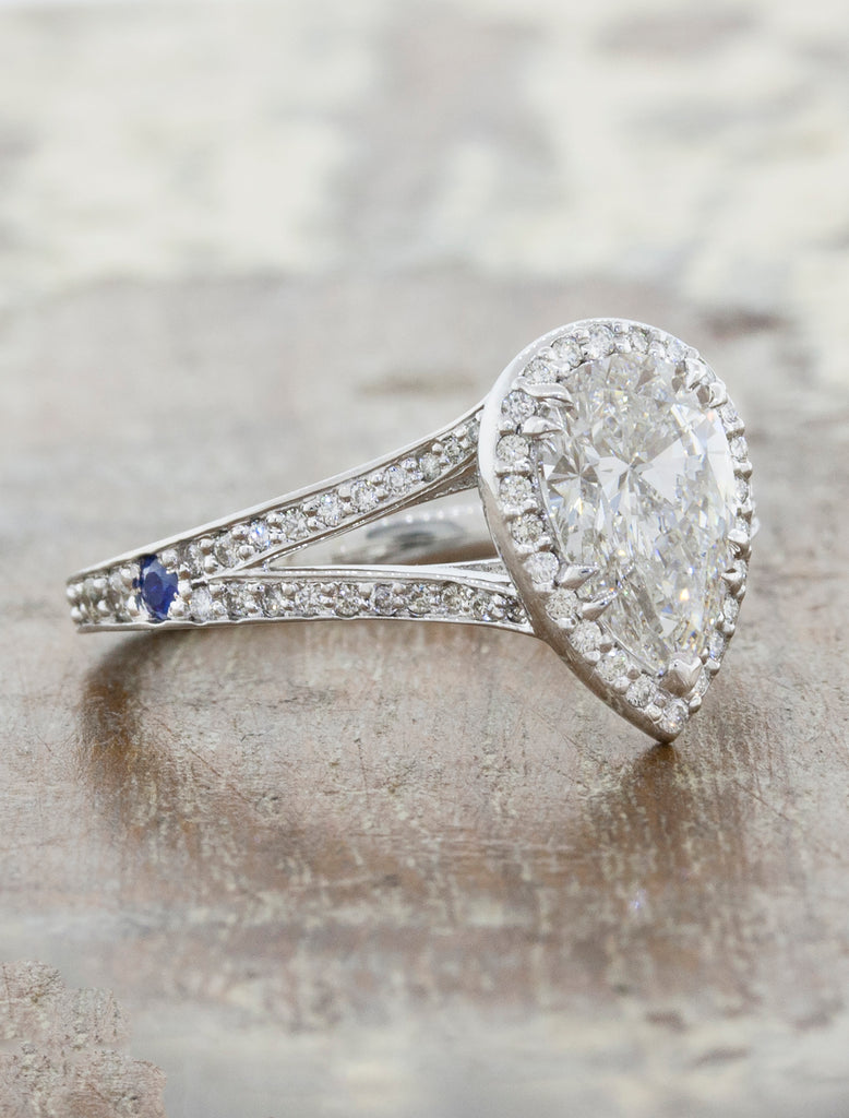 Halo engagement ring with pear shaped diamond and a split band