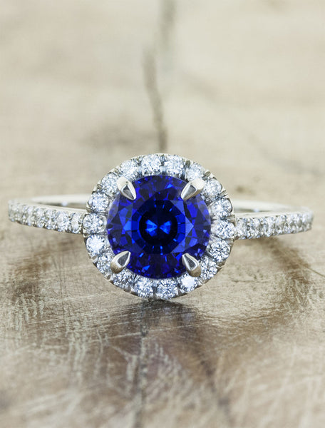 diamond halo sapphire engagement ring by Ken & Dana Design. caption:Customized with a blue sapphire center stone