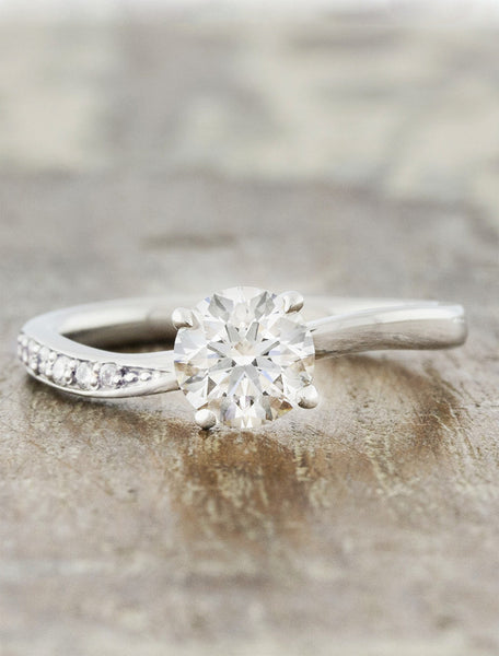sculptural band diamond solitaire engagement ring