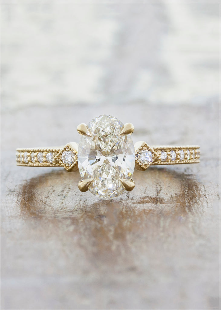 Vintage inspired engagement ring;caption:0.90ct. Oval Diamond 14k Yellow Gold