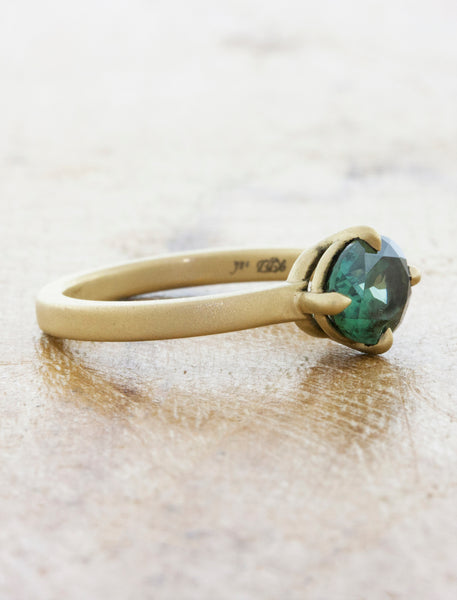 sideways oval sapphire in brushed yellow gold band