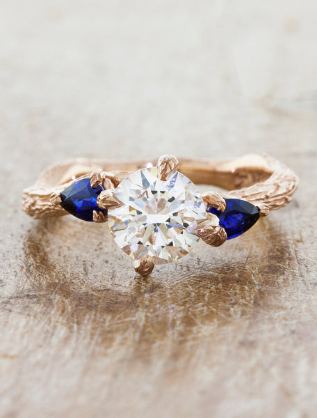 Nature inspired three stone setting;caption:1.00ct. Round Diamond and Sapphire 14k Rose Gold