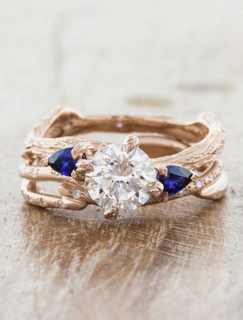 Nature inspired three stone setting;caption:1.00ct. Round Diamond and Sapphire 14k Rose Gold paired with Selene wedding band