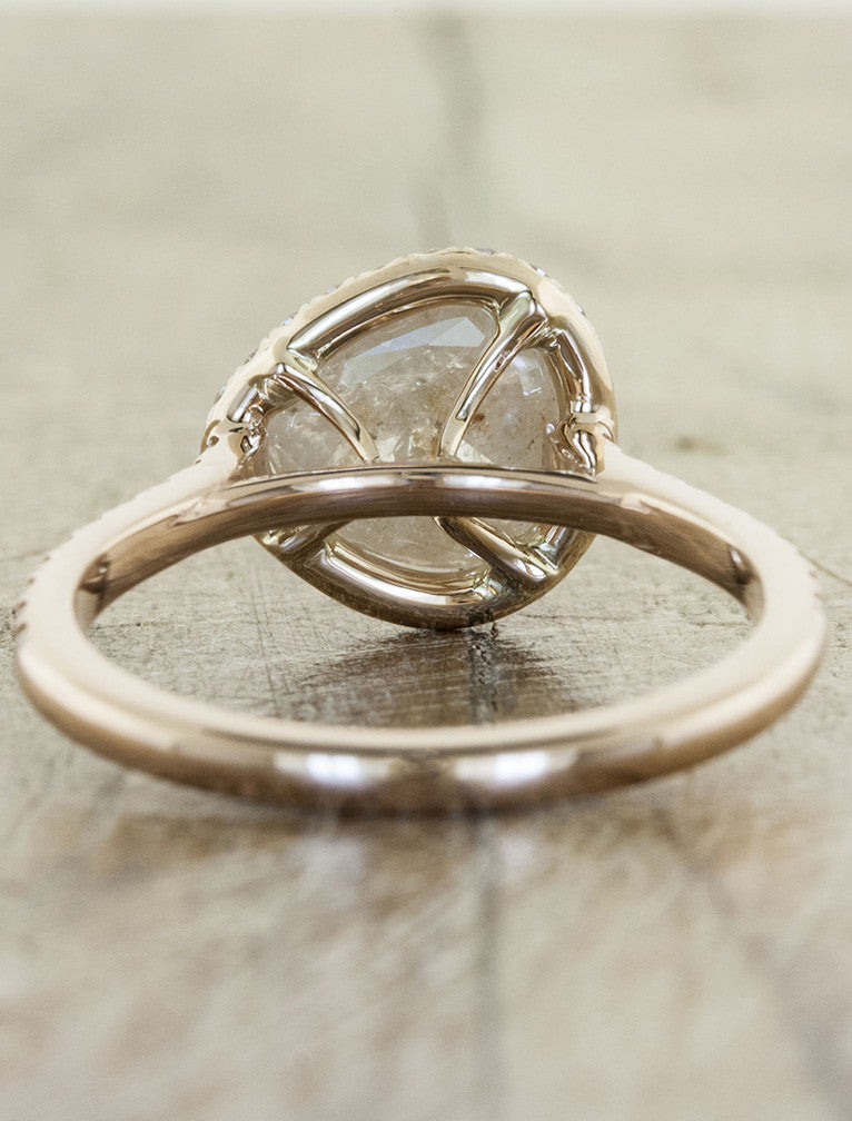 unique engagement ring with pear shaped diamond and a halo in rose gold