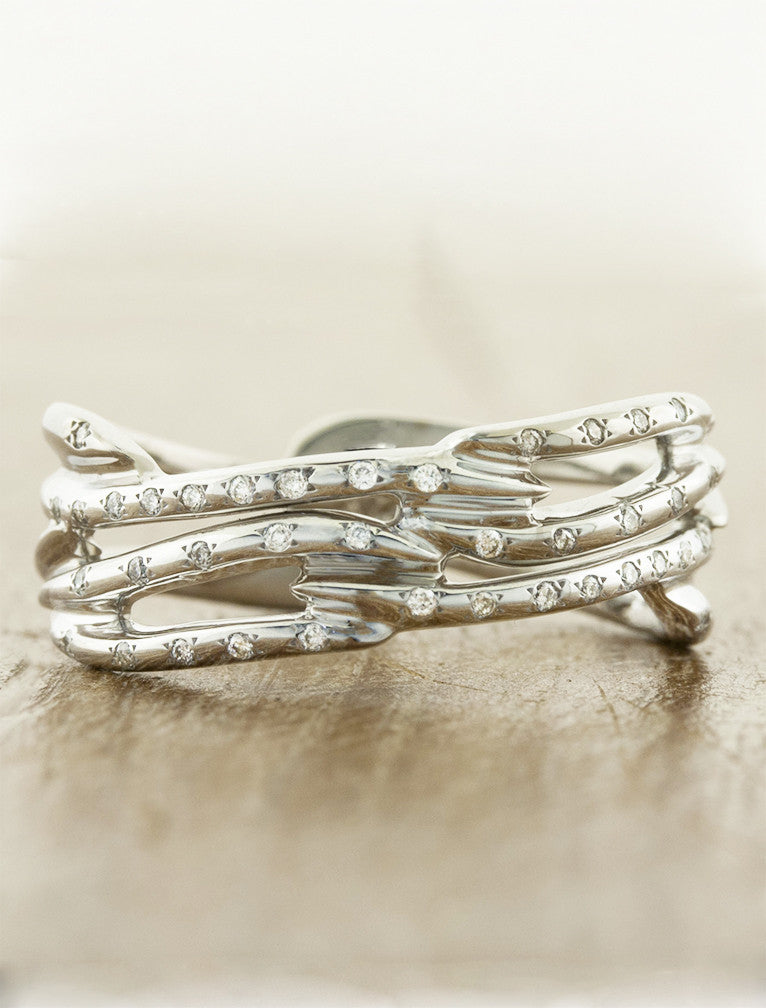 multi strand, split shank diamond accented wedding band. caption:Shown in 14k white gold