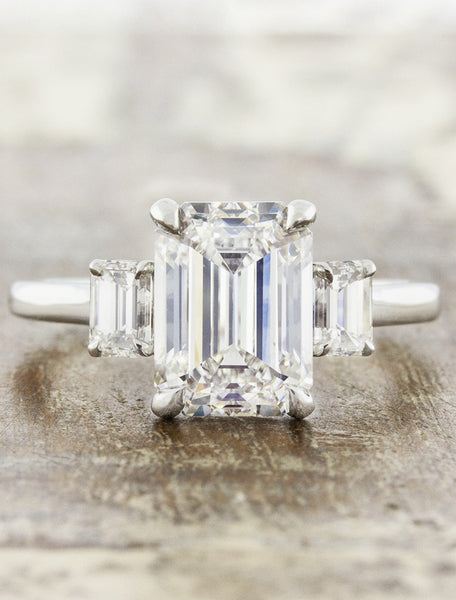 three stone emerald cut diamond engagement ring caption:3ct+ center diamond set with 0.50 tcw side stones
