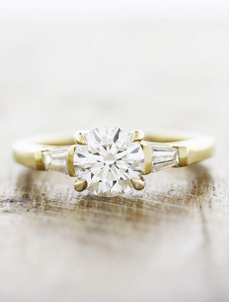 Three stone tapered baguette;caption:1.20ct. Round Diamond 14k Yellow Gold