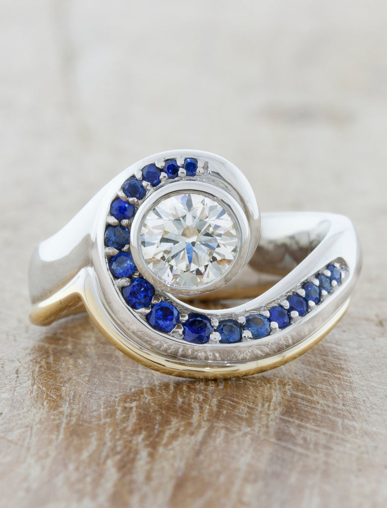 Asymmetrical Band Ring with Sapphire & Diamonds. caption:Shown with a 0.75ct center diamond