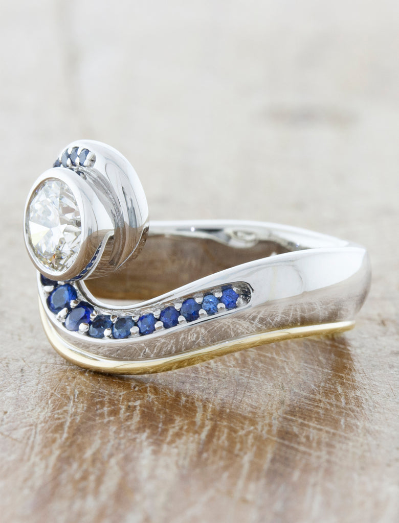Wave like diamond ring adored with sapphires