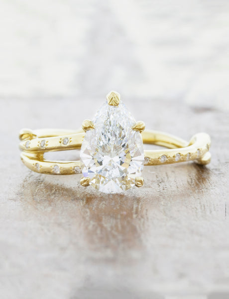 Nature inspired engagement ring. caption:Customized with an1.40ct. Pear Diamond 18k Yellow Gold