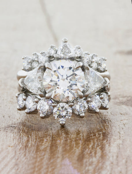 caption:Customized Antoinette, styled with a 3-stone engagement ring and the Tempest wedding band
