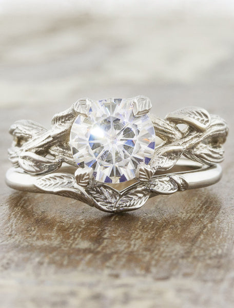 v-shaped leaf wedding band paired with leaf engagement ring